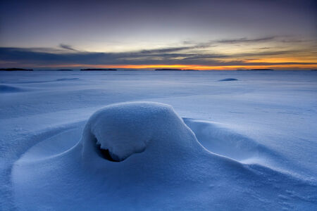 Snowy beach in winter morning in Finland photo