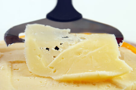 SLICER: Closeup of cheese with slicer , shallow dof
