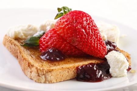 jam sandwich: Strawberry , jam and whipped cream on toast