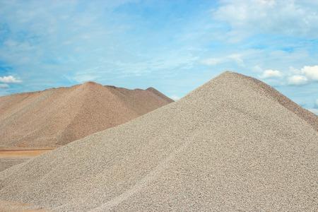 Sand heaps in gravel quarry construction