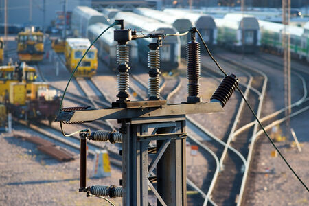 high voltage: High voltage electricity insulators on railroad yard