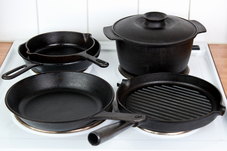 Seasoned cast iron cookware on electric stove