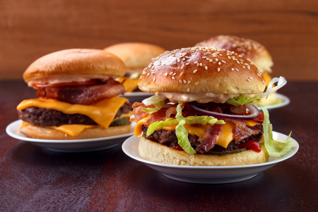 Group of burgers on dish with home baked buns