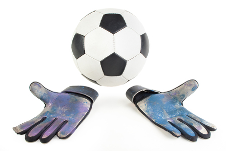 Soccer goalkeeper gloves and a ball, isolated on white(with small shadow) Standard-Bild - 107305628