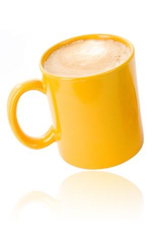 白に黄色のコーヒー カップ 写真素材