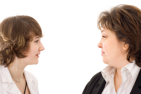 Mother and daughter talking with each other Stock Photo