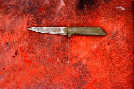 ナイフで赤グランジ背景 写真素材