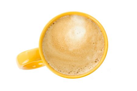 Yellow coffee cup on white. Top view