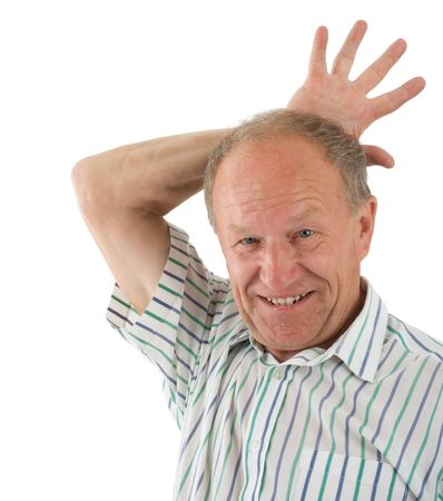 Aged man fooling about. White background photo