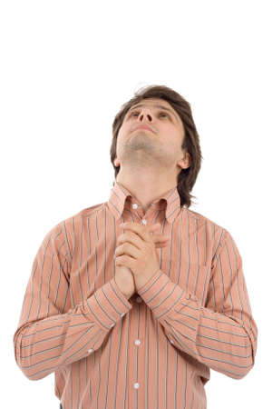 pleading: Young man praying. White background