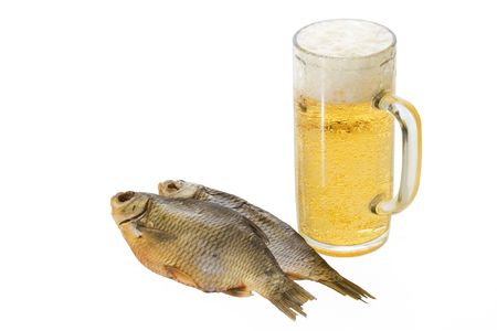 Mug with beer and dried fishes Stock Photo