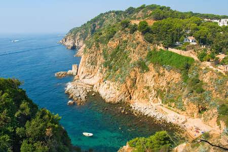 Rocks and calm sea near Tossa. Catalonia, Spain photo