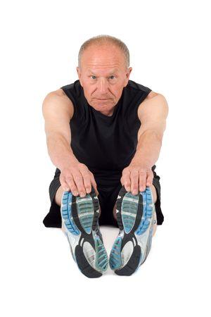 Senior man stretches before exercise