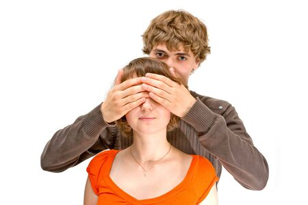 Young man covering girls eyes Stock Photo