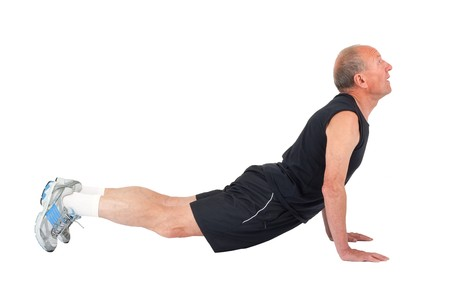 Senior man stretches before exercise