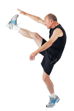 Fit senior man stretches before exercise Stock Photo