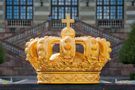 The golden crown near the Royal Palace in Stockholm Stock Photo
