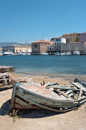 Old wrecked boat in the harbour of Chania. Crete, Greece photo