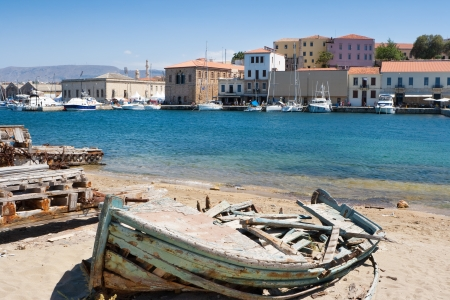Old wrecked boat in harbor of Chania. Crete, Greece photo