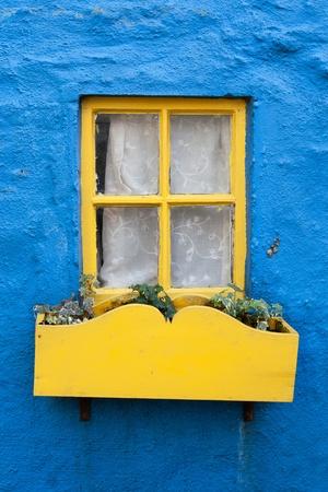 Yellow window on a blue wall. Ireland photo