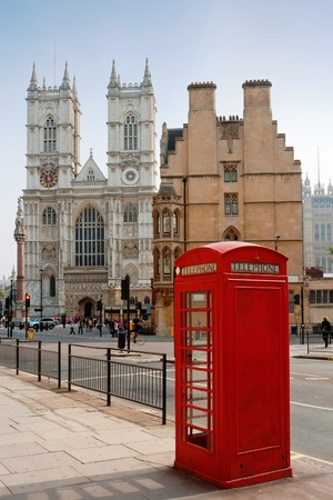 Red telephone box outside Westminster Abbey. London, UK Stock Photo