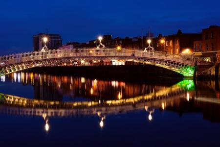 Hapenny bridge over Liffey river in Dublin. Ireland photo