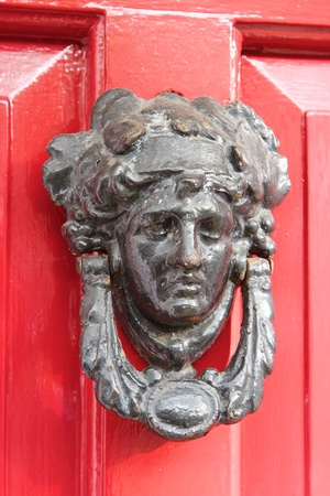 Door knocker with red door  Dublin  Ireland photo