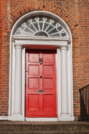Typical red wooden door  Dublin, Ireland, Europe photo
