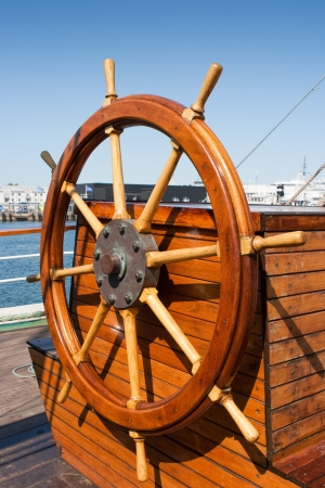 boat deck: Helm  steering wheel  of a sailing ship
