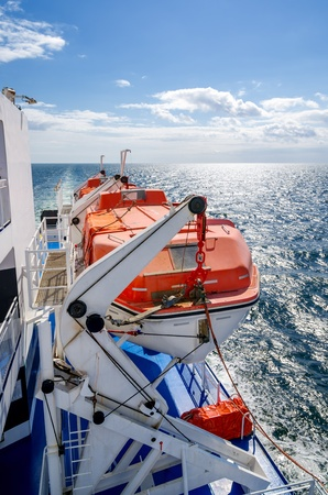 lifeboat: Red lifeboats on a cruise ship