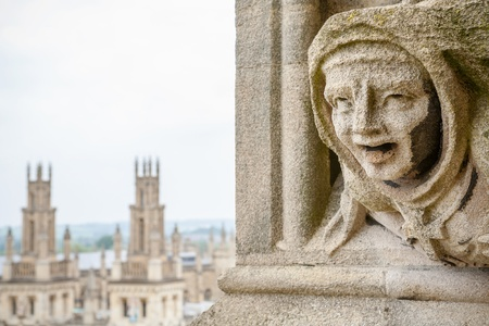 gargoyle: Carved Gargoyle Figure and All Souls College from St  Mary The Virgins Church  Oxford, England
