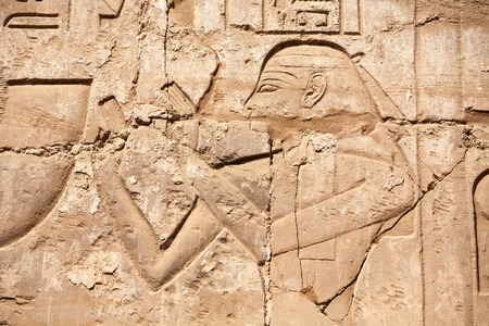 Carved Pharaoh figure on a wall  Karnak Temple, Luxor, Egypt photo