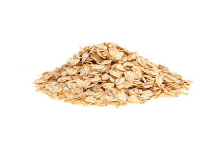 Heap of oat flakes - isolated on a white background photo