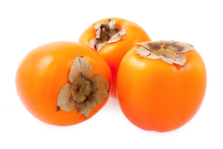Organic persimmon fruit - isolated on a white background Stock Photo - 24542556