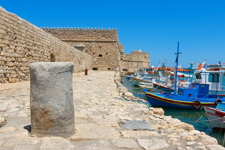 Fishing boats and Venetian Fortress in Heraklion harbour. Crete, Greece photo