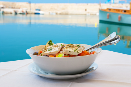 Greek salad with feta cheese on table  Rethymno, Crete, Greece