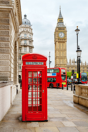 Red phone booth, double decker buses and Big Ben. London, England