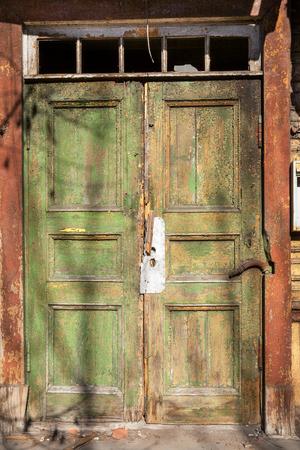 green door: Abandoned wooden door in Tallinn. Estonia