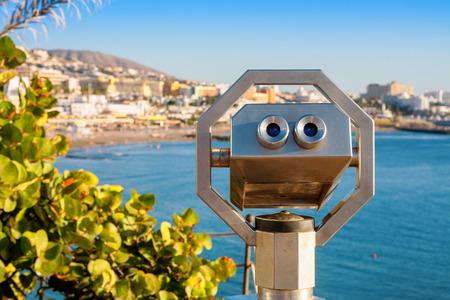 adeje: Binoculars overlooking Playa Fanabe. Costa Adeje, Tenerife, Canary Islands, Spain