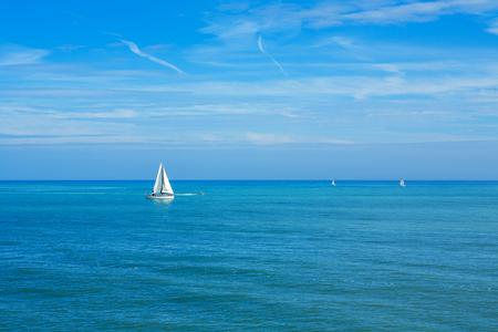 blue vessels: Yachts sailing on the sea. England, UK