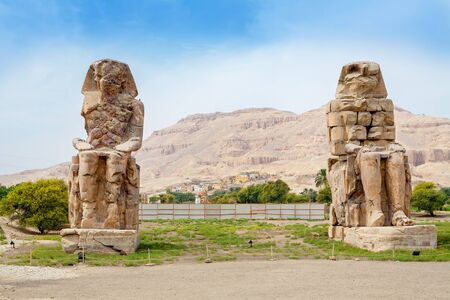 west bank: The Colossi of Memnon are two giant stone statues of Pharaoh Amenhotep III. Luxor, West Bank, Egypt