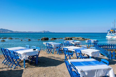 rhodes: Beach with traditional blue tables and chairs. Kolymbia. Rhodes, Greece