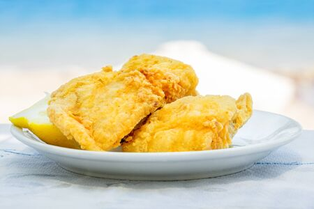 taverna: Plate of fried fish in Greek. Island of Rhodes, Greece
