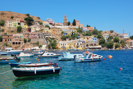 sea fishing: Fishing boats at the harbour of Symi. Dodecanese, Greece, Europe