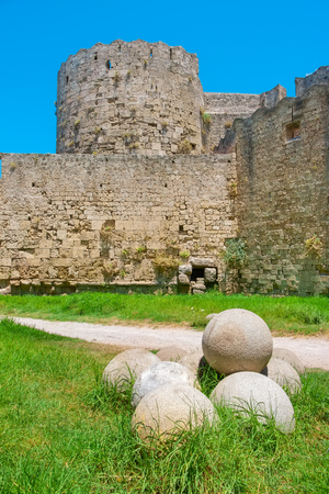 dodecanese: Canon balls in the moat of medieval fortress. City of Rhodes, Dodecanese, Greece, Europe