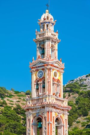 dodecanese: Bell tower of Panormitis Monastery in Symi. Dodecanese Islands, Greece Stock Photo