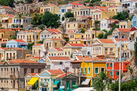 mediterranean houses: Traditional greek colorful houses in Symi island. Dodecanese, Greece. Stock Photo