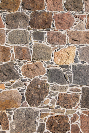 granite wall: A solid stone wall made of granite Stock Photo