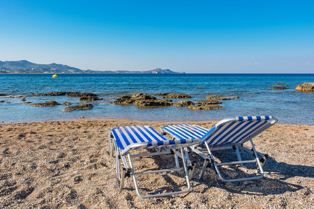 daybed: Deck chairs on a beach in Kolymbia. Rhodes, Dodecanese Islands, Greece