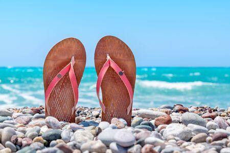 rhodes: Pair of flip flops on pebble beach. Rhodes, Greece